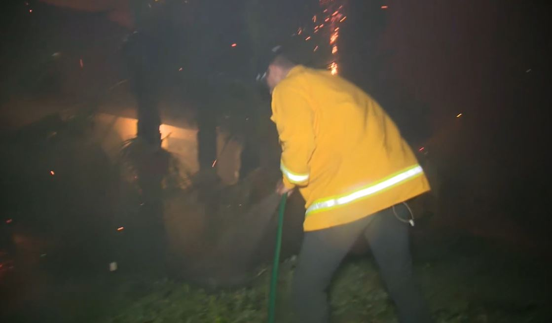 FOX 11 reporter Bill Melugin helps put out flames in Porter Ranch